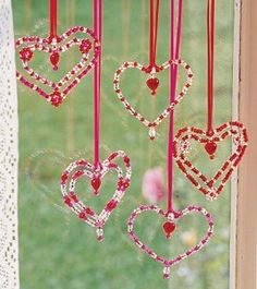 Valentine Window Hearts - kids' crafts - using chenille stems, beads, drops and ribbon (pin is a kit) ************************************************ Hearthsong - #Valentines #Day #kids #crafts #hearts #easy #beaded - tå√
