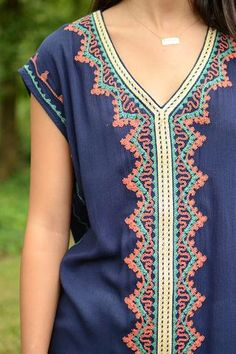 You need this navy embroidered tunic by THML! This short sleeve number is definitely one of a kind and we certainly can't take our eyes off of it! It features the same G O R G E O U S stitch work you