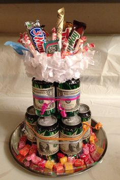 "I made this soda ""cake"" for my brothers birthday. It was fun because I had NO idea what to get a 19 yr old boy. There are 9 cans with $9 and a $10 bill on top to make $19."