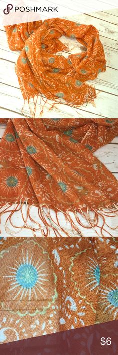 "Rust orange 🍂 70"" scarf 70"" lightweight scarf - a deep orange almost rust - perfect for autumn! Covered in medallions with an almost faint teal circle. Never worn but I fund one small spot that appears to be part of fabric or dye process and is easily hidden. See pic 4. Accessories Scarves & Wraps"