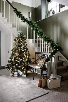 Leaving more room for unwrapping presents in the sitting room, the entrance hall is a great place to position your tree, creating an instantly festive feeling for guests on arrival. http://www.hglivingbeautifully.com/2015/12/02/make-an-entrance-ideas-for-decorating-your-hallway-this-christmas/