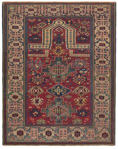 Caucasian Kazak Prayer Rug, 4ft 1in x 5ft 3in, Circa 1875. The French dame's second husband ambitiously amassed a first-rate group of Caucasian rugs, including this wonderfully idiosyncratic prayer rug. Its surprising elements include its double prayer niche and the fanciful overscale guls (stylized flowers) that ascend the field. Its boldly rendered Kufic design border is borrowed from the Shirvan and Kuba rugs of the Eastern Caucasus.