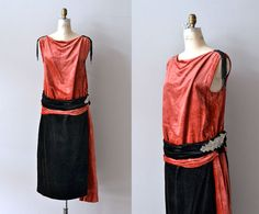 1920s dress with persimmon silk velvet bodice and trailing sash, black silk velvet skirt and banded waist, black beaded shoulder tassels and dropped waist with large rhinestone mesh hip detail.