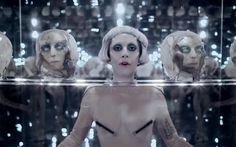 """Lady Gaga Sued By French Artist Orlan For $31.7 Million - """"Orlan, is asking recompense for what she sees as a suspicious similarity between one of her sculptures and the opening scene of Gaga's """"Born This Way"""" video. [...] the lawsuit accuses Gaga of using the same """"plexiglass support, same square shape when it comes to the haircut, same facial implants, same decapitated heads,"""" as Orlan's 1996 sculpture """"Femme Avec Tête,"""" or """"Woman With Head"""""""""""