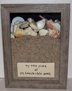 Seaside-themed shadowbox souvenir! How about a custom-sized beach poster for the background, so you're looking off into the sunset? More