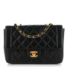 This is an authentic CHANEL Vintage Lambskin Quilted Medium Single Flap in Dark Brown. This stunning vintage model is finely composed of luxuriously supple diamond quilted lambskin leather in brown.