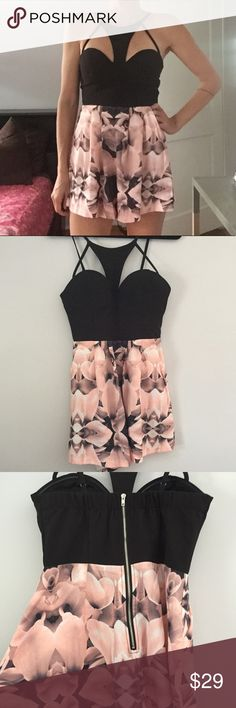 Hello Molly Playsuit EUC Romper from U.K. Brand Hello Molly. Top is black bustier with supported cups. Bottom is abstract pink floral flowy short. Exposed back zipper. Adjustable. UK 10 is US 6. Hello Molly Pants Jumpsuits & Rompers