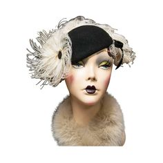 1930s Beaver Felt Skull Hat with Marabou Feathers | From a collection of rare vintage hats at https://www.1stdibs.com/fashion/accessories/hats/