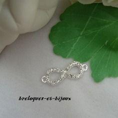 Magnifique connecteur 3 .5 cm  bijou forme 8 argente avec zircon strass pour creations bijoux colliers ou autres