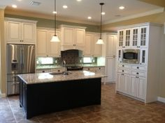 white cabinets, dark island with prep sink, must have solid quartz countertops and backsplash