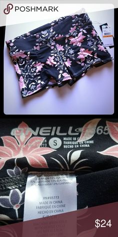 "O'Neill Endure Shorts Stretchy, sweat wicking workout shorts in grey with a cute pink floral pattern. The high-quality fabric smooths over lines and imperfections. Beware, these are short! Waist measures approx 13.5"" lying flat. 8.5"" long from top of waist. Waistband has small pocket for ipod or key. NWT. O'Neill Shorts"