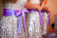 Glitzy silver and purple bridesmaid dresses....