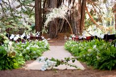 Modern and romantic pair together to create the perfect backdrop using copper ceremony arch with white orchids and branches and rustic isle runner with ferns and white orchids. Design by Waterlily Pond Studio www.waterlilypond.  Santa Lucia Preserve, Carmel Valley. Larissa Cleveland Photography.