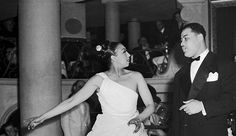 Josephine Baker urging Joe Louis to sing with her during her opening performance at the Club Des Champs Elysees in Paris in the early 1950s. Photo: Rene Henry/Bettman Corbis.