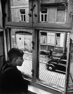 Boy looking out of window, Ansbach, Germany  photo by Carl Mydans, 1954