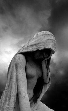 grief - sadness - statue - female - head lowered - hand on face - arm - torso - hood - black and white -