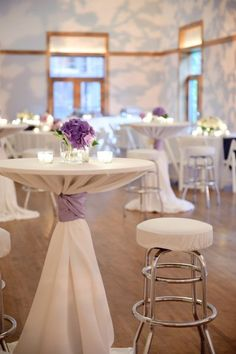 Purple and white cocktail tables. Great pref set up.