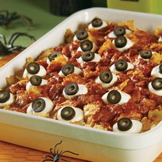 "OP: The ""eyeballs"" that top our spooky casserole are made from mozzarella cheese and sliced olives. But the cheesy, baked pasta that lies below is a real treat that everyone will enjoy."