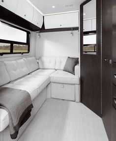 The all-new Unity FLEX from Leisure Travel Vans features a sofa and ottoman in the rear.