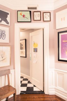 A Look at Andy and Kate Spade's Art Collection: Art Filled Apartment Entrance with Black and White Tile Floors | coveteur.com