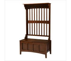 Hall Tree Storage Bench - Keep your mud room or entryway neat & tidy with thisstorage bench. Spacious seating area flips up to reveal a large storage section. Features a split seat, allowing the user to rest on one side of the bench, while retrieving articles from the storage compartment on the opposite side. A back panel with four hooks is perfect for hats & coats. Rich walnut finish will compliment virtually any decor. Ships ready to assemble. www.millstores.com