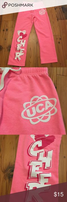 UCA Varsity Cheer Sweatpants Pink Size XS These sweatpants are in very gently used condition.   They were purchased at a UCA cheer camp.  Size XS.   Please contact me with any questions. Thank you for looking! 😃 Varsity Pants Track Pants & Joggers
