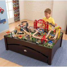 The Kidkraft Metropolis Table and Train Set lets kids take control of an entire city. The train set is loaded with fun features and interactive pieces and the high-quality wooden table takes playtime Train Set Table, Wooden Train, Classic Toys, Model Trains, Kids Playing, Kids Room, Kid Kraft, Sensory Boards, Play Table