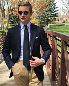 Mr. Derek Bleazard Navy jacket. Sky bengal stripe classic collar shirt. White tv fold pocketsquare. Black woven tie. chinos.