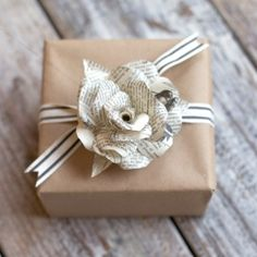 How to make a paper flower from a book or dictionary page, perfect to adorn a wedding favor or gift.