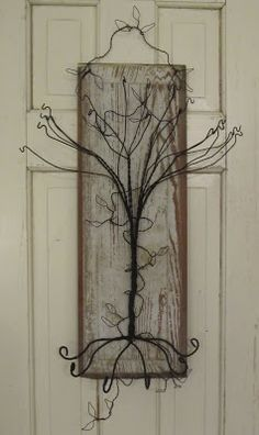 Take one chippy old door panel......add a twisty wire tree......and you have a funky and functional jewelry holder for hanging on the wall. ...