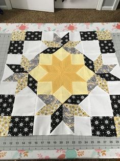 block in yellow and black from pattern Winter's Grandeur Mini Quilt. I'm going to use as a center for a stars themed block of the month just finishing up.Faceted star quilt Looks dramatic but not complicatedLove this color combo! Star Quilt Blocks, Star Quilt Patterns, Star Quilts, Mini Quilts, 24 Blocks, Scrappy Quilts, Pattern Blocks, Quilting Projects, Quilting Designs