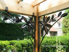 Magnolia Branch Metal Brackets, hand forged by Maryland Blacksmith, Matthew Harris, owner of Harris Metalsmith Studio. Beautiful custom ironwork