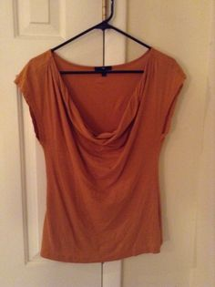 Gap mustard orange drapey top. Size S, but runs large in the chest, for the draping. Swap or sell.
