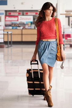 A knit sweater, wrap skirt and slouchy boots makes for the perfect comfortably chic flying outfit.