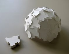 Paper Unit Dome    based on 60 face polyhedron  (deltoidal/trapezoidal hexecontahedron)  120mm diameter  made from one A4 t=0.2mm paper