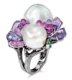 Cellini Jewelers Baroque Pearl and Sapphire Ring Two South Sea baroque pearls, purple and pink briolette and cabochon sapphires, and round tsavorites, are arranged in an assymetrical design, topping a 'branch-shaped' shank; in blackened 18-karat gold.  Dimensions: vertical ring height (from top pearl to bottom pearl) 1 3/8 inches.
