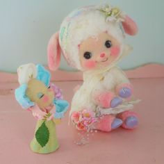 Retro little lamb with a flower friend.  Love this.  Found on R wool felt production diary