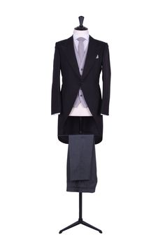 Grooms classic black herringbone tailcoat with grey ascot tie, single breasted traditional waistcoat and pocket square and grey pin stripe trousers