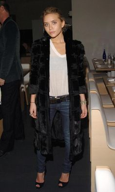 Ashley Olsen in a black fur coat, white tee & jeans #style #fashion #mka #celebrity