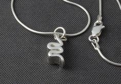 Unique, contemporary, handmade silver ribbon design pendant, minimal quirky pendant, wave pendant, modern pendant on silver snake chain
