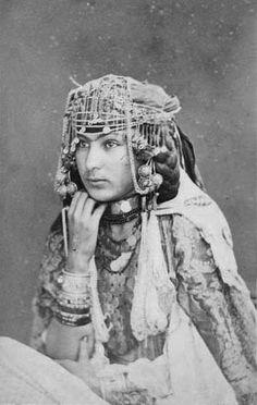 Africa | Studio portrait of an Ouled Nail woman. Algiers, Algeria. ca. 1870s | Photo taken by J. Berthomier