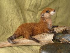 Needle felted otter and fish poseable hand dyed wool by Ainigmati