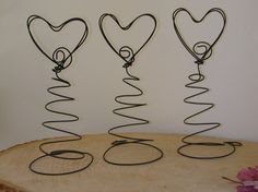 12 Table Number Card  Holders / Menu / Picture Holders / Valentine ( WHIMSICAL Rustic Wire HEART ). $33.00, via Etsy.