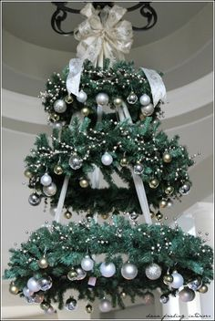"Clever adaption of basic wreath forms into a tree shape...a way to get a ""tree"" mounted to the ceiling, away from cats...OK, MAYBE away from the cats..."