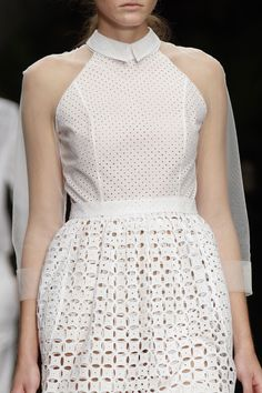 Chic white dress with sheer sleeves + dainty cut out patterns and perforations; fashion details // Simone Rocha
