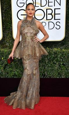 Chrissy Teigen wore this champagne lace gown by Marchesa for the 74th annual Golden Globes. Click to see what other celebrities have been wearing this awards season!