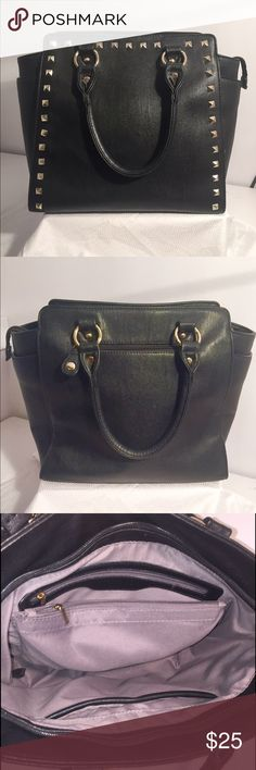 Purse Black studded faux leather tote bag. Comes with a detachable strap. Spacious on the inside. Has one zipper pocket on the back and two side pockets. Used a few times, great condition! Bags Totes