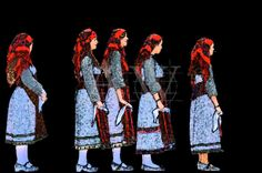 Khorus - A group of traditional Greek dancers patiently waiting for their turn to perform at the Strawberry Festival in a village of Rhodes.