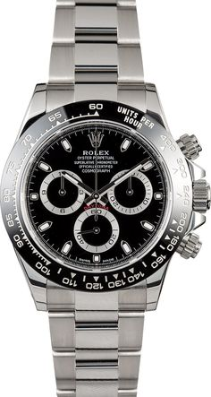 Manufacturer: Rolex Model Name/Number: Daytona 116500LN Serial/Year: Random - 2016 or Newer Grade: (What's This?) II Gender: Men's Movement/Features: Automatic 4130 calibre movement, chronograph, scratch-resistant sapphire crystal, waterproof screw-down Triplock crown, 100 meters/330 feet, minute markers around outer rim, chronograph; hour, minute, second, Parachrom hairspring Case: Stainless steel (40mm) w/ black monobloc Cerachrom bezel, engraved...