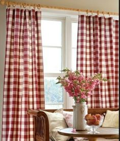 Buffalo checked fabric on a simple wooden curtain rod makes this room the essence of chic country.